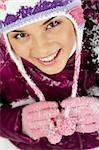 Pretty woman in winter clothes looking at camera with smile Stock Photo - Royalty-Free, Artist: pressmaster                   , Code: 400-06461471