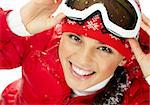 Pretty woman in goggles and winter clothes looking at camera with smile Stock Photo - Royalty-Free, Artist: pressmaster                   , Code: 400-06461472
