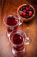 Hot drink with cranberries on white Stock Photo - Royalty-Freenull, Code: 400-06461722
