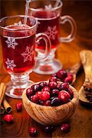 Cranberries in wooden bowl with hot mulled wine Stock Photo - Royalty-Freenull, Code: 400-06461723