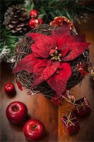 Christmas flower with decoration on wooden table Stock Photo - Royalty-Freenull, Code: 400-06461741