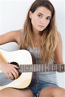 Portrait of Teenage Girl Playing Acoustic Guitar Stock Photo - Premium Royalty-Freenull, Code: 600-06465374