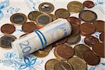 Roll of European Bills on top of Euro Coins Stock Photo - Premium Rights-Managed, Artist: Ursula Klawitter, Code: 700-06465383