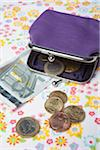 Purple Change Purse with European Coins and Paper Currency on Patterned Background Stock Photo - Premium Rights-Managed, Artist: Ursula Klawitter, Code: 700-06465384