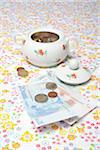 Sugar Bowl Filled with Euro Coins and Paper Money on Table Stock Photo - Premium Rights-Managed, Artist: Ursula Klawitter, Code: 700-06465386