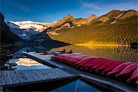 fall trees lake - Red Canoes on Dock at Dawn, Lake Louise, Banff National Park, Alberta, Canada Stock Photo - Premium Rights-Managednull, Code: 700-06465426