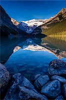 snow capped - Lake Louise at Dawn, Banff National Park, Alberta, Canada Stock Photo - Premium Rights-Managednull, Code: 700-06465430