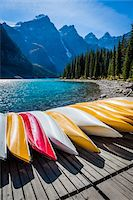 Row of Canoes on Dock, Moraine Lake, Banff National Park, Alberta, Canada Stock Photo - Premium Rights-Managednull, Code: 700-06465435