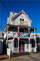 quaint house - House Exterior with Shark Tour Banner on Balcony, Wesleyan Grove, Camp Meeting Association Historical Area, Oak Bluffs, Martha's Vineyard, Massachusetts, USA Stock Photo - Premium Rights-Managednull, Code: 700-06465749