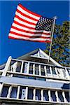 Low Angle View of House Flying American Flag from Balcony, Wesleyan Grove, Camp Meeting Association Historical Area, Oak Bluffs, Martha's Vineyard, Massachusetts, USA Stock Photo - Premium Rights-Managed, Artist: R. Ian Lloyd, Code: 700-06465750
