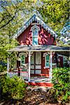 Quaint Red House with Porch Surrounded by Trees and Shrubs, Wesleyan Grove, Camp Meeting Association Historical Area, Oak Bluffs, Martha's Vineyard, Massachusetts, USA Stock Photo - Premium Rights-Managed, Artist: R. Ian Lloyd, Code: 700-06465758