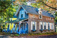 quaint house - Cottage with Chairs on Porch, Wesleyan Grove, Camp Meeting Association Historical Area, Oak Bluffs, Martha's Vineyard, Massachusetts, USA Stock Photo - Premium Rights-Managednull, Code: 700-06465763