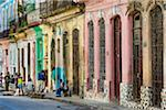 People Hanging Out on Street in front of Multi-Colored Buildings, Havana, Cuba Stock Photo - Premium Rights-Managed, Artist: R. Ian Lloyd, Code: 700-06465902
