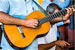 Close-Up of Man Playing Guitar in Band, Taberna de La Muralla, Plaza Vieja, Havana, Cuba Stock Photo - Premium Rights-Managed, Artist: R. Ian Lloyd, Code: 700-06465919