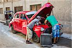 Two Men Repairing Classic Car, Havana, Cuba Stock Photo - Premium Rights-Managed, Artist: R. Ian Lloyd, Code: 700-06465933