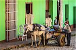 Man with Horse Drawn Cart in front of Green Building, Trinidad, Cuba Stock Photo - Premium Rights-Managed, Artist: R. Ian Lloyd, Code: 700-06465972