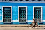 Man Riding Bicycle Past Bright Blue Building, Trinidad, Cuba Stock Photo - Premium Rights-Managed, Artist: R. Ian Lloyd, Code: 700-06465973