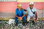 Portrait of Two Men Sitting on Curb and Smoking Cigars, Trinidad, Cuba Stock Photo - Premium Rights-Managed, Artist: R. Ian Lloyd, Code: 700-06465974