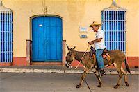 Man Riding Donkey, Trinidad, Cuba Stock Photo - Premium Rights-Managednull, Code: 700-06465975