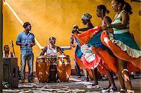 Afro Cuban Musicians and Dancers at Palenque de los Congos Reales, Trinidad, Cuba Stock Photo - Premium Rights-Managednull, Code: 700-06465990