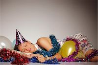 streamer - Woman asleep among party balloons and streamers Stock Photo - Premium Rights-Managednull, Code: 849-06466097