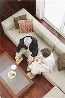 Above view of senior adult couple having tea on the sofa Stock Photo - Premium Rights-Manag