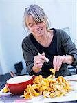 Woman cleaning chanterelles, Sweden. Stock Photo - Premium Royalty-Free, Artist: Science Faction, Code: 6102-06470516