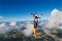 Parachute jumpers in the sky, Sweden. Stock Photo - Premium Royalty-Freenull, Code: 6102-06470611