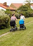 Women walking with baby carriages, Sweden. Stock Photo - Premium Royalty-Free, Artist: CulturaRM, Code: 6102-06470645
