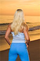 female rear end - A blond woman working out on a beach, Portugal. Stock Photo - Premium Royalty-Freenull, Code: 6102-06470719