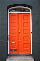 An orange door, Denmark. Stock Photo - Premium Royalty-Freenull, Code: 6102-06470754