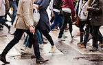 Close-up of people on zebra crossing Stock Photo - Premium Royalty-Free, Artist: Oriental Touch, Code: 6102-06471155