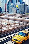 Yellow taxi on Brooklyn Bridge with skyscrapers in background Stock Photo - Premium Royalty-Free, Artist: Robert Harding Images, Code: 6102-06471242