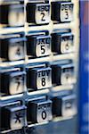 Close-up of Numbers on Pay Phone Keypad with Selective Focus Stock Photo - Premium Royalty-Free, Artist: Damir Frkovic, Code: 600-06471344
