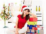 Happy Asian female leaning on stack of Christmas gift, preparation of Christmas day. Stock Photo - Royalty-Free, Artist: szefei                        , Code: 400-06477676