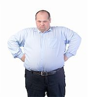Happy Fat Man in a Blue Shirt, isolated Stock Photo - Royalty-Freenull, Code: 400-06480135