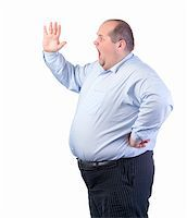 Fat Man in a Blue Shirt, Shouting, isolated Stock Photo - Royalty-Freenull, Code: 400-06480136