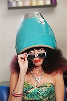 retro beauty salon images - Pouting lady with frizzy hair sitting under hair dryer Stock Photo - Royalty-Freenull, Code: 400-06480418
