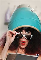 retro beauty salon images - Surprised female reading magazine while under hair dryer Stock Photo - Royalty-Freenull, Code: 400-06480419