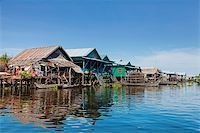 flooded homes - Floating fishing village Kampong Phluk on Tonle Sap Lake in Cambodia Stock Photo - Royalty-Freenull, Code: 400-06481550
