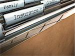 focus on the word insurance written onto a folder with the word family on the background, blur effect and room for text at the bottom Stock Photo - Royalty-Free, Artist: olivier26                     , Code: 400-06482350