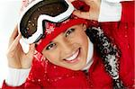 Pretty woman in goggles and winter clothes looking at camera with smile Stock Photo - Royalty-Free, Artist: pressmaster                   , Code: 400-06482816