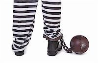 prisoner's legs and ball and chain on white, view from behind Stock Photo - Royalty-Freenull, Code: 400-06484843