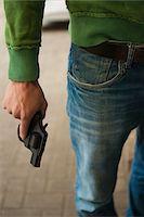 Close-up of Young Man holding Handgun, Mannheim, Baden-Wurttemberg, Germany Stock Photo - Premium Royalty-Freenull, Code: 600-06486019