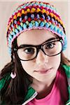 Close-up Portrait of Girl wearing Woolen Hat and Horn-rimmed Eyeglasses, Looking at Camera, Studio Shot on White Background Stock Photo - Premium Royalty-Free, Artist: Uwe Umsttter, Code: 600-06486286