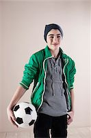 Portrait of Boy with Soccer Ball in Studio Stock Photo - Premium Royalty-Freenull, Code: 600-06486401