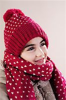 Portrait of Girl wearing Hat and Scarf in Studio Stock Photo - Premium Royalty-Freenull, Code: 600-06486409