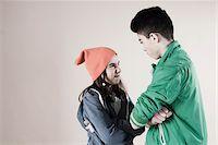 Girl and Boy Arguing in Studio Stock Photo - Premium Royalty-Freenull, Code: 600-06486435