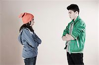 Boy and Girl Arguing in Studio Stock Photo - Premium Royalty-Freenull, Code: 600-06486436