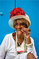 Portrait of Woman Wearing Hat and Smoking Large Cigar, Old Havana, Havana, Cuba Stock Photo - Premium Rights-Managednull, Code: 700-06486574